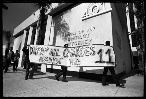 Students hold a protest outside the offices of the district attorney of Orange County in solidarity with the Irvine 11