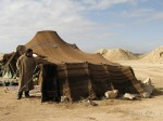 A Bedouin tent near Zagora. Bedouin (play /ˈbɛdʉ.ɪn/; from the Arabic badawī بَدَوِي, pl. badū بَدْو or al-badaw البَدَوِ) are a part of a predominantly desert-dwelling Arabian ethnic group traditionally divided into tribes or clans, known in Arabic as ʿašāʾir (عَشَائِر).  Their tents are made from goat or camel hair and vegetable fibers, sewn together and dyed black.