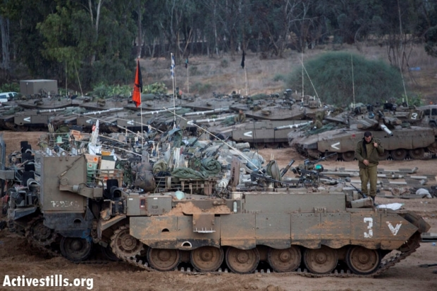 IDF tanks gather near Gaza Strip in preparation for a possible ground invasion. The Israeli government has authorized drafting 75,000 reservists for the next stages in the military campaign (photo: Actiestills)