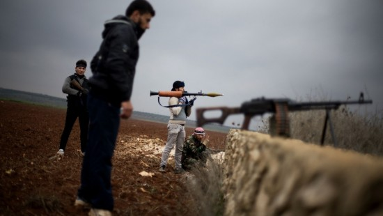 Free Syrian Army fighters take their positions, close to a military base, near Azaz, Syria, Monday, Dec. 10, 2012.  Photo by Manu Brabo/AP