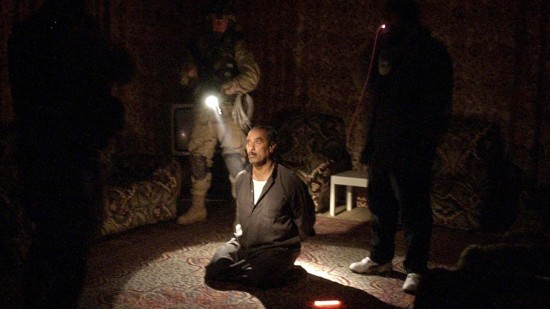 In this Wednesday, Jan. 14, 2004 file photo, a man suspected of involvement in attacks on coalition forces is questioned in the living room of his home during a raid by the 82nd Airborne Division near Fallujah, Iraq. In 2014, the city's fall to al-Qaida-linked forces has touched a nerve for the service members who fought and bled there. Photo by Julie Jacobson/AP
