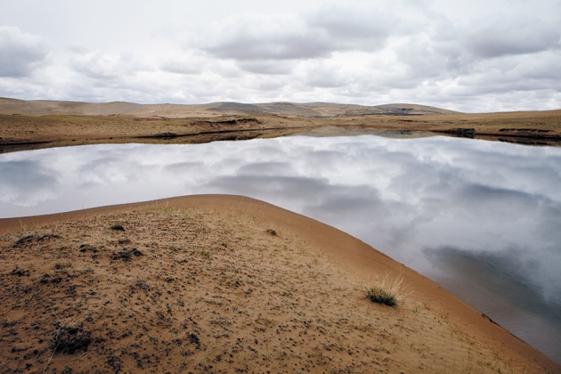 Near the headwaters of the Yellow River, lush grasslands have given way to sand dunes. Photo by Jonas Bendiksen/Magnum
